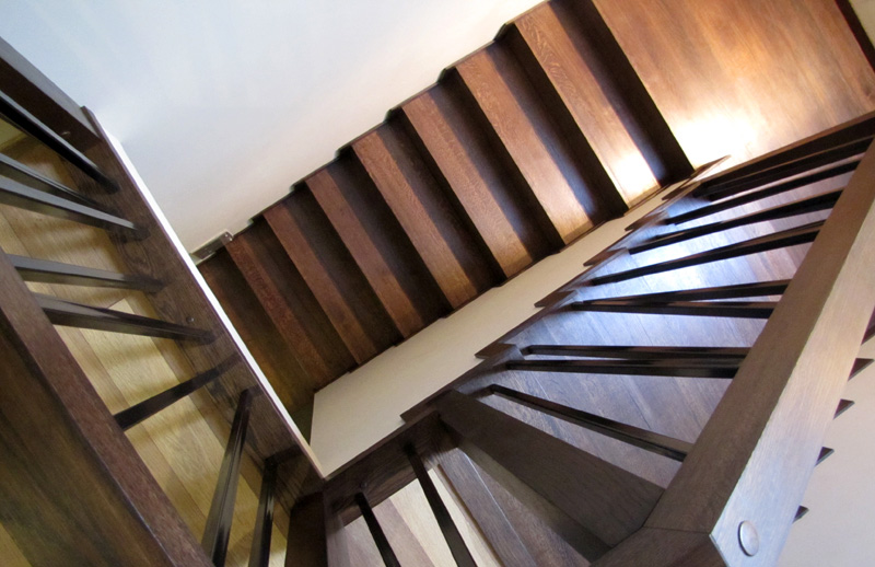 Wooden stairs installed on concrete